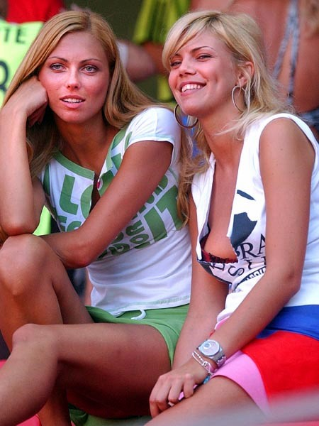Russian soccer team supporters Elena Nelidova, right, and Katia Polianskaya wait for the start of the Euro 2004 Group A soccer match between Portugal and Russia