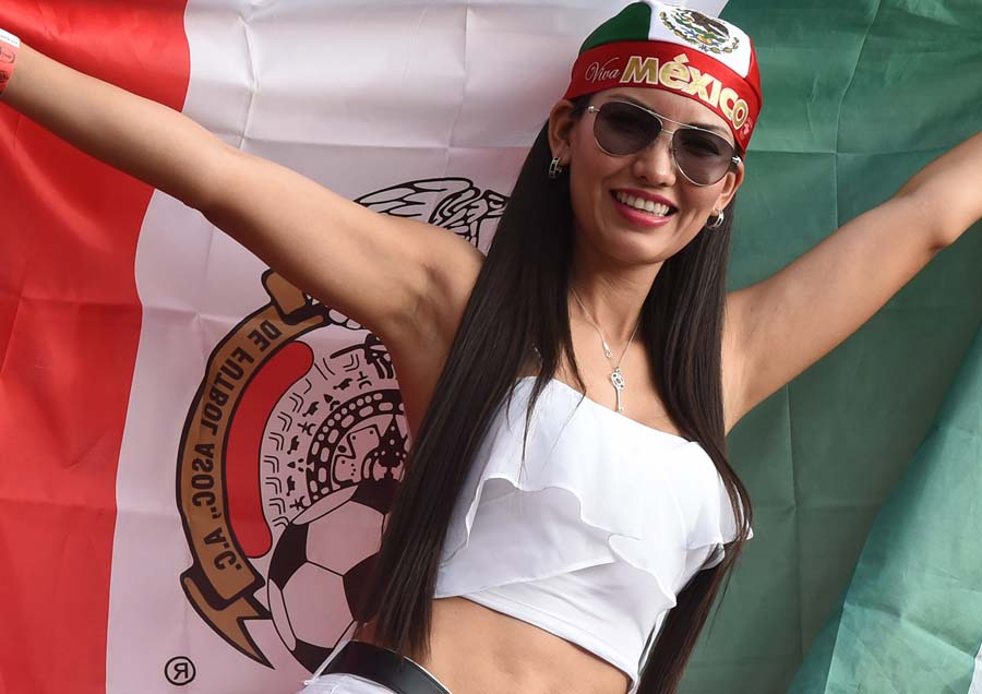 A Mexican fan poses prior to a Group A football match between Croatia and Mexico at the Pernambuco Arena in Recife during the 2014 FIFA World Cup on June 23, 2014.  AFP PHOTO / YURI CORTEZ