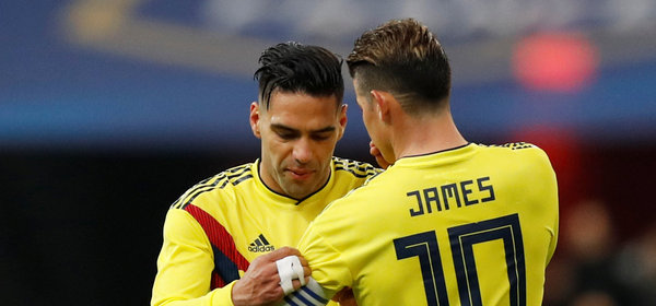 Soccer Football - International Friendly - France vs Colombia - Stade De France, Saint-Denis, France - March 23, 2018   Colombia's Radamel Falcao passes the captain's armband to James Rodriguez before he is substituted   REUTERS/Gonzalo Fuentes