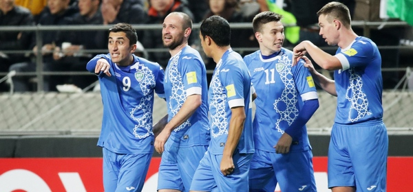 SEOUL, SOUTH KOREA - NOVEMBER 15:  Marat Bikmaev (2nd L) of Uzbekistan celebrates scoring his team's first goal with his team mates during the 2018 FIFA World Cup qualifying match between South Korea and Uzbekistan at Seoul World Cup Stadium on November 15, 2016 in Seoul, South Korea.  (Photo by Chung Sung-Jun/Getty Images)