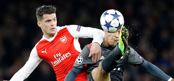 Bayern's Thiago Alcantara, right, is challenged by Arsenal's Granit Xhaka during the Champions League round of 16 second leg soccer match between Arsenal and Bayern Munich at the Emirates Stadium in London, Tuesday, March 7, 2017. (AP Photo/Frank Augstein)