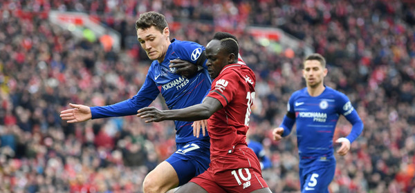 LIVERPOOL, ENGLAND - APRIL 14:  Sadio Mane of Liverpool battles with Andreas Christiansen of Chelsea during the Premier League match between Liverpool FC and Chelsea FC at Anfield on April 14, 2019 in Liverpool, United Kingdom. (Photo by Michael Regan/Getty Images)