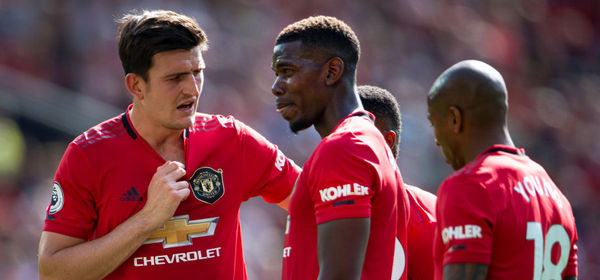 MANCHESTER, ENGLAND - AUGUST 24: Harry Maguire and Paul Pogba of Manchester United during the Premier League match between Manchester United and Crystal Palace at Old Trafford on August 24, 2019 in Manchester, United Kingdom. (Photo by Visionhaus/Getty Images)