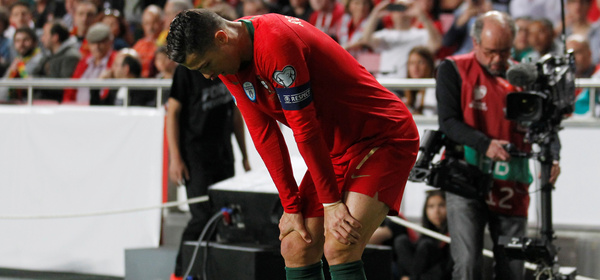 Soccer Football - Euro 2020 Qualifier - Group B - Portugal v Serbia - Estadio da Luz, Lisbon, Portugal - March 25, 2019  Portugal's Cristiano Ronaldo stands injured before being substituted off REUTERS/Rafael Marchante