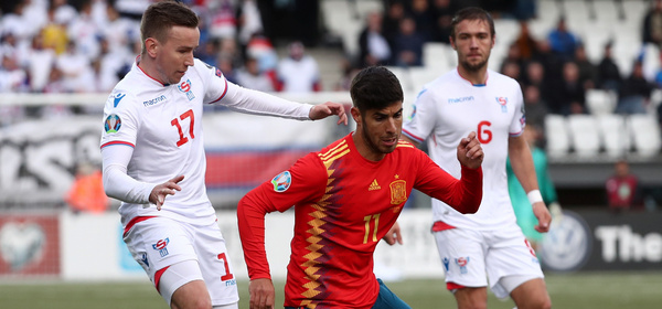 Soccer Football - Euro 2020 Qualifier - Group F - Faroe Islands v Spain - Torsvollur, Torshavn, Faroe Islands - June 7, 2019  Spain's Marco Asensio in action with Faroe Islands' Arni Frederiksberg            REUTERS/Sergio Perez