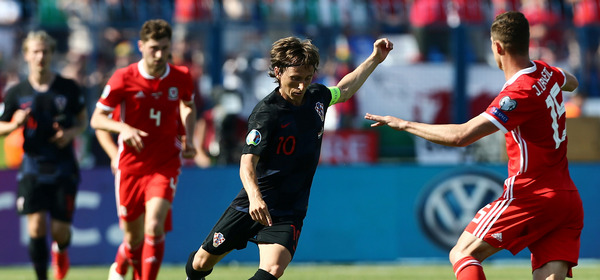 Soccer Football - Euro 2020 Qualifier - Group E - Croatia v Wales - Stadion Gradski vrt, Osijek, Croatia - June 8, 2019  Croatia's Luka Modric in action with Wales' Jamie Lawrence   REUTERS/Antonio Bronic