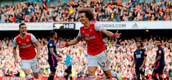 Asenal's Brazilian defender David Luiz (C) celebrates after scoring the opening goal of the English Premier League football match between Arsenal and Bournemouth at the Emirates Stadium in London on October 6, 2019. (Photo by Tolga AKMEN / AFP) / RESTRICTED TO EDITORIAL USE. No use with unauthorized audio, video, data, fixture lists, club/league logos or 'live' services. Online in-match use limited to 120 images. An additional 40 images may be used in extra time. No video emulation. Social media in-match use limited to 120 images. An additional 40 images may be used in extra time. No use in betting publications, games or single club/league/player publications. /  (Photo by TOLGA AKMEN/AFP via Getty Images)