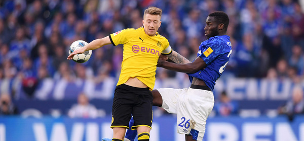 GELSENKIRCHEN, GERMANY - OCTOBER 26: Marco Reus of Borussia Dortmund is challenged by Salif Sane of FC Schalke 04 during the Bundesliga match between FC Schalke 04 and Borussia Dortmund at Veltins-Arena on October 26, 2019 in Gelsenkirchen, Germany. (Photo by Alex Grimm/Bongarts/Getty Images)