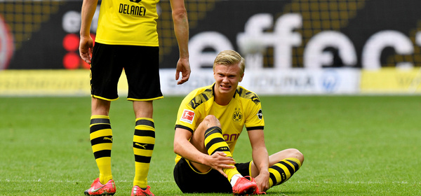 Soccer Football - Bundesliga - Borussia Dortmund v Schalke 04 - Signal Iduna Park, Dortmund, Germany - May 16, 2020 Dortmund's Erling Braut Haaland down injured, as play resumes behind closed doors following the outbreak of the coronavirus disease (COVID-19) Martin Meissner/Pool via REUTERS  DFL regulations prohibit any use of photographs as image sequences and/or quasi-video