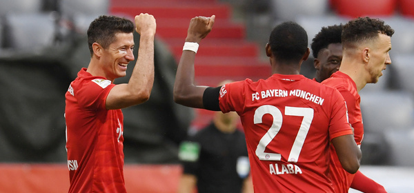 Bayern Munich's Polish forward Robert Lewandowski (L) celebrates scoring the third goal with Bayern Munich's Austrian defender David Alaba during the German first division Bundesliga football match between FC Bayern Munich and Eintracht Frankfurt on May 23, 2020 in Munich, southern Germany. DFL REGULATIONS PROHIBIT ANY USE OF PHOTOGRAPHS AS IMAGE SEQUENCES AND/OR QUASI-VIDEO   / AFP / POOL / ANDREAS GEBERT / DFL REGULATIONS PROHIBIT ANY USE OF PHOTOGRAPHS AS IMAGE SEQUENCES AND/OR QUASI-VIDEO