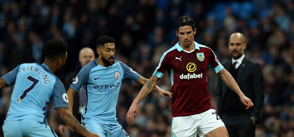 MANCHESTER, ENGLAND - JANUARY 02:  George Boyd of Burnley controls the ball from Raheem Sterling of Manchester City during the Premier League match between Manchester City and Burnley at Etihad Stadium on January 2, 2017 in Manchester, England.  (Photo by Jan Kruger/Getty Images)