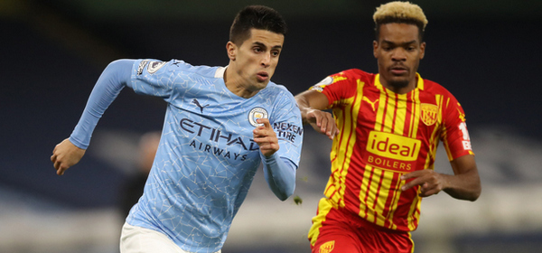 MANCHESTER, ENGLAND - DECEMBER 15: Joao Cancelo of Manchester City runs past Grady Diangana of West Bromwich Albion during the Premier League match between Manchester City and West Bromwich Albion at Etihad Stadium on December 15, 2020 in Manchester, England. The match will be played without fans, behind closed doors as a Covid-19 precaution.  (Photo by Martin Rickett - Pool/Getty Images)