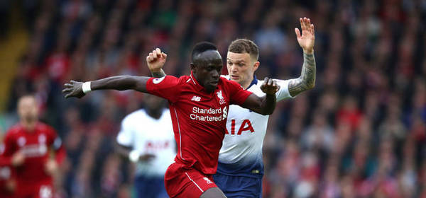 LIVERPOOL, ENGLAND - MARCH 31: Saido Mane of Liverpool is tackled by Kieran Trippier of Tottenham Hotspur  during the Premier League match between Liverpool FC and Tottenham Hotspur at Anfield on March 31, 2019 in Liverpool, United Kingdom. (Photo by Clive Brunskill/Getty Images)