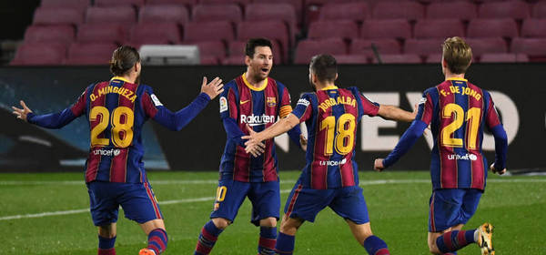 BARCELONA, SPAIN - DECEMBER 16: Jordi Alba of Barcelona  celebrates after scoring their team's first goal with Oscar Mingueza, Lionel Messi, and Frenkie de Jong of Barcelona  during the La Liga Santander match between FC Barcelona and Real Sociedad at Camp Nou on December 16, 2020 in Barcelona, Spain. Sporting stadiums around Spain remain under strict restrictions due to the Coronavirus Pandemic as Government social distancing laws prohibit fans inside venues resulting in games being played behind closed doors. (Photo by David Ramos/Getty Images)
