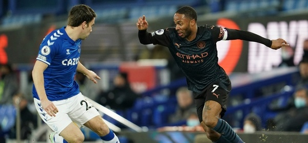 Everton's Seamus Coleman, left, competes for the ball with Manchester City's Raheem Sterling during the English Premier League soccer match between Everton and Manchester City at Goodison Park stadium, in Liverpool, England, Wednesday, Feb. 17, 2021. (Jon Super/Pool via AP)