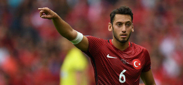epa05359147 Hakan Calhanoglu of Turkey reacts during the UEFA EURO 2016 group D preliminary round match between Turkey and Croatia at Parc des Princes in Paris, France, 12 June 2016.  (RESTRICTIONS APPLY: For editorial news reporting purposes only. Not used for commercial or marketing purposes without prior written approval of UEFA. Images must appear as still images and must not emulate match action video footage. Photographs published in online publications (whether via the Internet or otherwise) shall have an interval of at least 20 seconds between the posting.)  EPA/GEORGI LICOVSKI   EDITORIAL USE ONLY