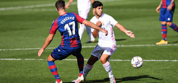 VILLAREAL, SPAIN - OCTOBER 04: Nikola Vukcevic of Levante  battles for possession with  Marco Asensio of Real Madrid  during the La Liga Santander match between Levante UD and Real Madrid at Ciutat de Valencia Stadium on October 04, 2020 in Valencia, Spain. Football Stadiums around Europe remain empty due to the Coronavirus Pandemic as Government social distancing laws prohibit fans inside venues resulting in fixtures being played behind closed doors. (Photo by Alex Caparros/Getty Images)