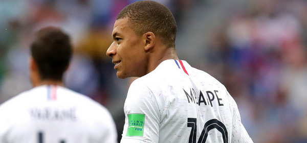 NIZHNY NOVGOROD, RUSSIA - JULY 06:  Kylian Mbappe of France celebrates after teammate Antoine Griezmann scores their team's second goal during the 2018 FIFA World Cup Russia Quarter Final match between Uruguay and France at Nizhny Novgorod Stadium on July 6, 2018 in Nizhny Novgorod, Russia.  (Photo by Alexander Hassenstein/Getty Images)